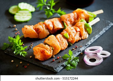 Couple of raw marinated  and spicy chicken skewers