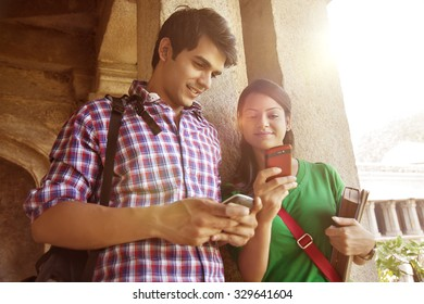 Couple reading an sms on a mobile phone