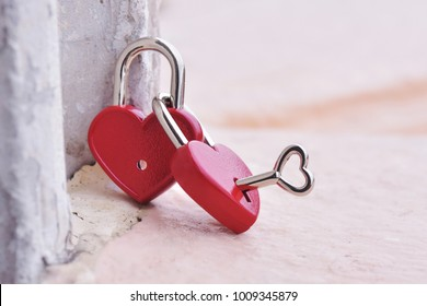Couple red heart lock with key  lean against vintage pole, valentine love symbol