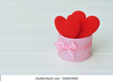 Couple red love heart in the pink gift box