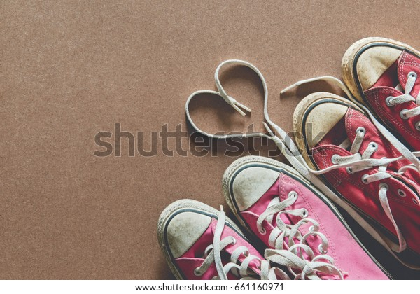Couple red and pink sneakers shoes with heart shape