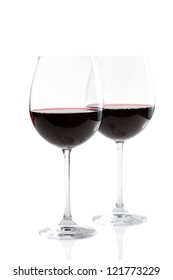Couple of red wine glasses isolated on white