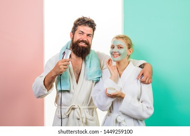 Couple. Relationship. Bearded man with electric shaver. Cosmetic facial mask. Morning treatments. Health. Morning. Morning routine. Family life. Husband and wife. Morning procedures.