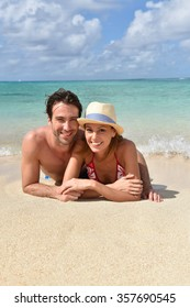 Couple relaxing on the beach in Caribbean island