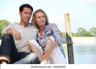 Couple relaxing on a pontoon