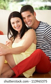 Couple Relaxing On Sofa At Home