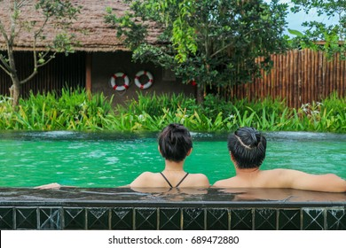 couple relaxing on swimming pool concept about love,relationship