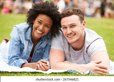 Couple Relaxing At Outdoor Summer Event