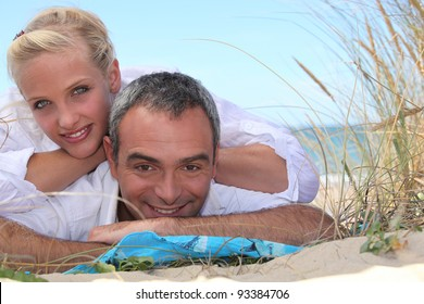 Couple relaxing at the seaside