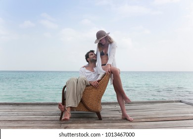 Couple relaxing together on deck