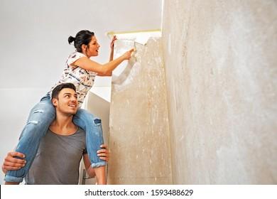 Couple Renovating the New Dwelling, Piggyback