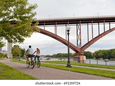 Couple riding bicycles along Mississippi River in Saint Paul, Minnesota