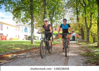 Couple riding an E-Bike during vacations