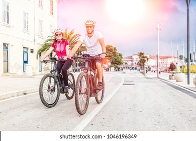 Couple riding E-Bikes during vacations