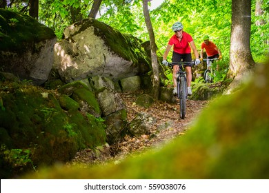 A couple riding their mountain bikes on single track trail in Ontario, Canada