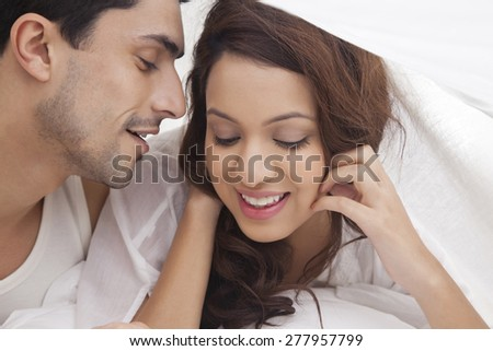 couple romancing bed stock photo edit now 277957799 shutterstock
