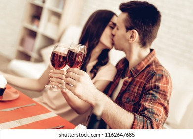Couple Romantic Dinner At Valentine's Day. Love Each Other. Sweetheart's Holiday Concept. Wine Drinking. Feelings Showing. Celebrating Date Together. Young And Handsome. Beautiful Kiss.