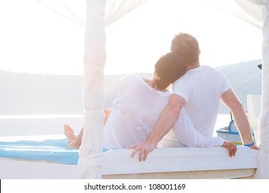 Couple in romantic hug at the sea