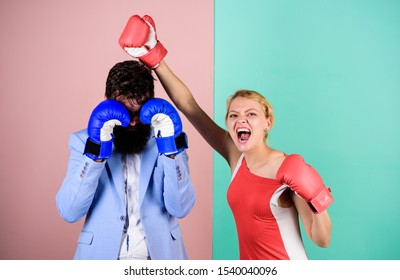 Couple romantic relationships. Man and woman boxing fight. Boxers fighting gloves. Difficult relationships. Couple in love competing boxing. Conflict concept. Family life. Complicated relationships.