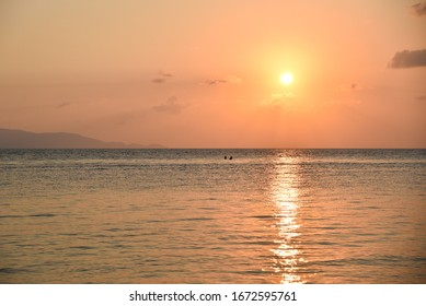 A couple is rowing in beautiful view, happy Sunset time