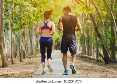 Couple runner working on exercise and warm up to jogging and running outdoors in nature