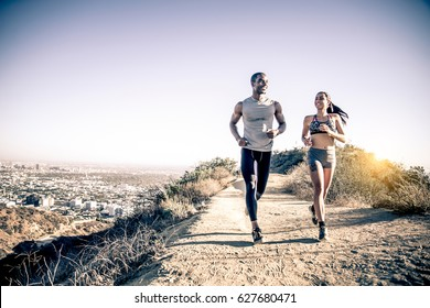 Couple of runners training outdoors - Two sportive people running