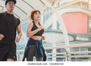 Couple running in the city at morning. Health conscious concept.