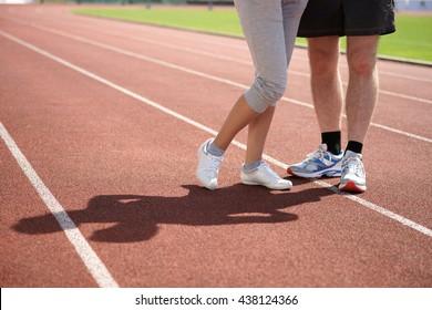 Couple running feet