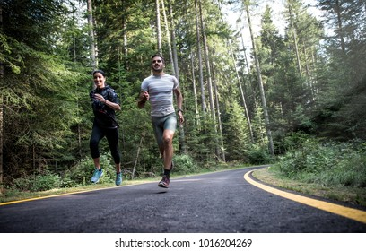 Couple running in the forest