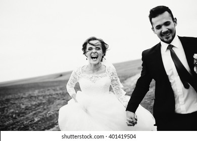 Couple is running happily in the wedding day