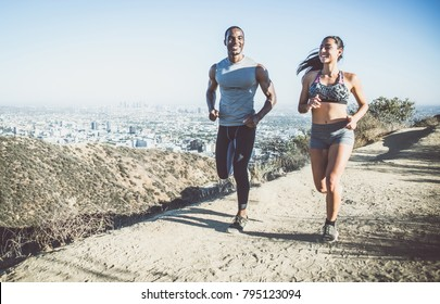 Couple running in los angeles canyons.