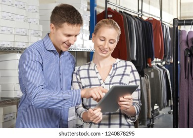 Couple Running On Line Fashion Business In Warehouse