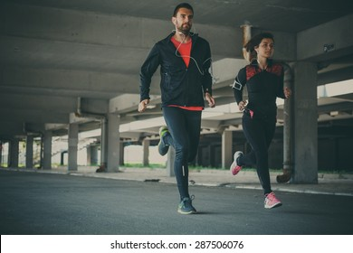 Couple running in an urban environment
