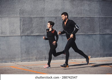 Couple running in an urban environment