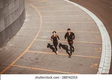 Couple running in an urban environment. Bird`s eye view
