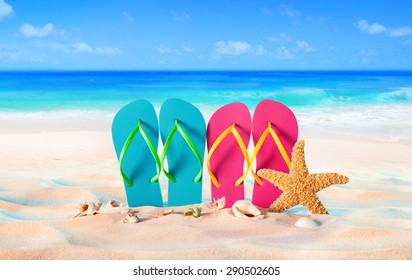 couple sandals and shells on sand - beach holiday in two - Summer