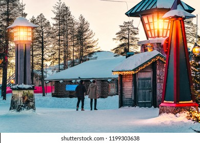 Couple in Santa Claus Village in Rovaniemi in Lapland in Finland.