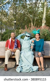 Couple sat with performance artist