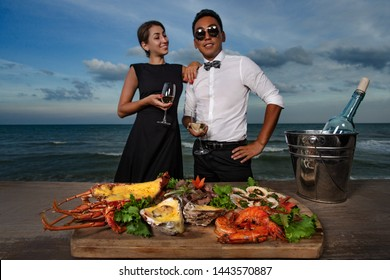 Couple in a seafood restaurant - cheers with wine glasses