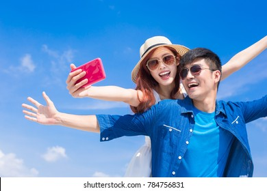 couple selfie happily with the blue sky