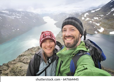Couple selfie - tourists in Norway. Bessegen trail hike in Jotunheimen National Park.
