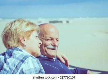 couple of seniors on the beach