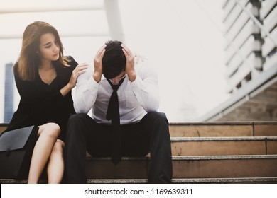 Couple with serious Tired depressed unemployed man sitting in city,Encouragement concept.
