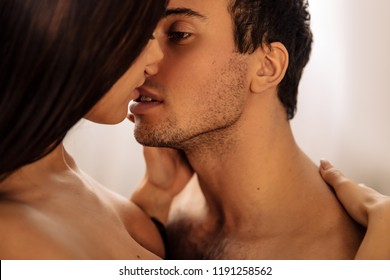 Couple. Sex. Passion. Young sexy man and woman are kissing passionately