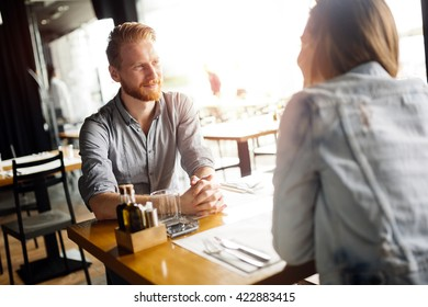 Couple sharing precious moments together in restaurant