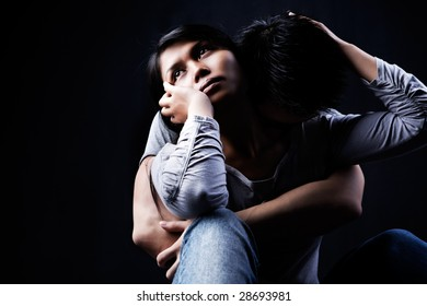 A couple sharing their sorrow.