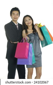 Couple with shopping bags over white background