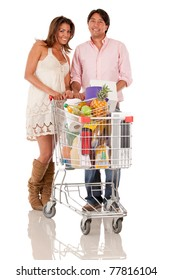 Couple with a shopping cart - isolated over a white background