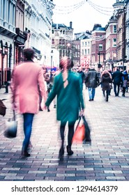 A couple shopping on busy street