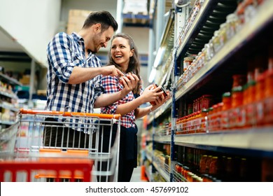 Couple shopping at supermarket together